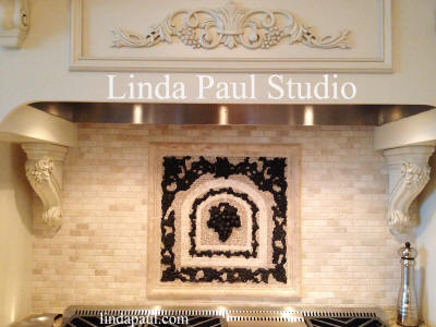 subway tile backsplash with 20 x 20 Chateua grape medallion in BR OR