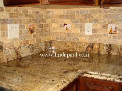 kitchen backsplash ideas on a budget - tile accents by artist Linda Paul