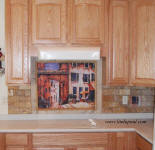 a day in provence mural back splash with gold travertine subway tile