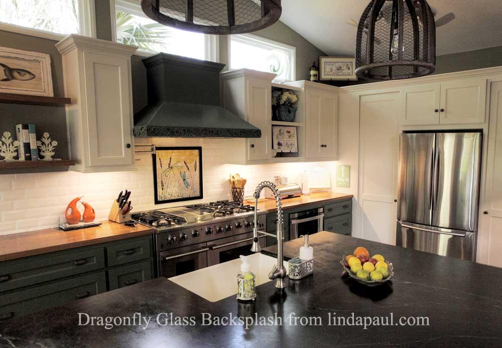 dragonfly glass backsplash art in black and white kitchen