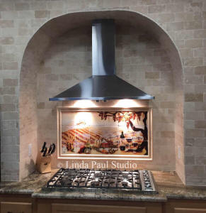 vineyard backsplash in arched stove alcove