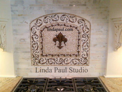 arched kitchen fleur de lys medallion mosaic tile backsplash