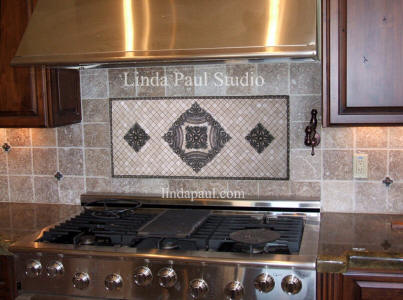custom backsplash with baroque frame and rachels flower accents
