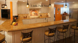designer kitchen with mural backsplash