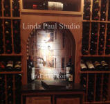 close up of french bristro mural in custom wine cellar