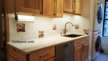 new york laundry room with tiles backsplash