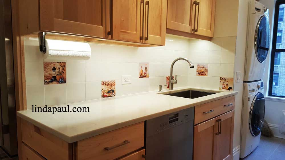 Backsplash with accent tiles