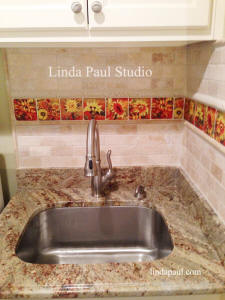 sunflower accent tile in laundry room sink space
