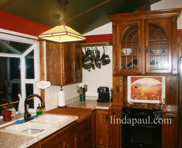 country kitchen with sunflower backsplash