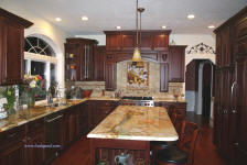 tuscan kichen with cherry cabinets and granite island