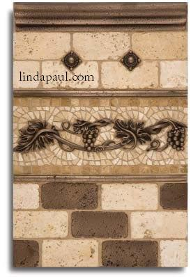 back splash tile design with metal tiles and accents