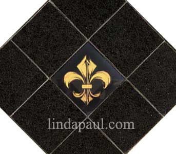 black and gold fleur de lis tile in black granite