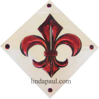 burgundy wine colored fleur de lis tile