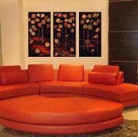 large contemporary paintings of aspentrees over red sofa