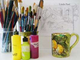 artists tools and inspiration - lemons coffee cup and paint supplies