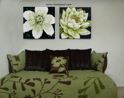 linda Paul's Lotus and Clematis flower painting over brwon and green sofa bed