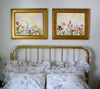 picture of flower paintings in bedroom