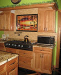mexican sunset backsplash with black border tile