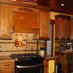 installation picture of tuscan tiles with copper accents