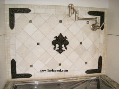 fleur de lis and studded bracket backsplash idea