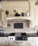 Ravenna plaque in neutral kitchen with black granite
