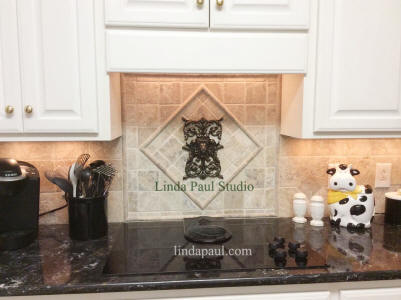 regency Lion onlay installed over stove on tumbled marble kitchen tile
