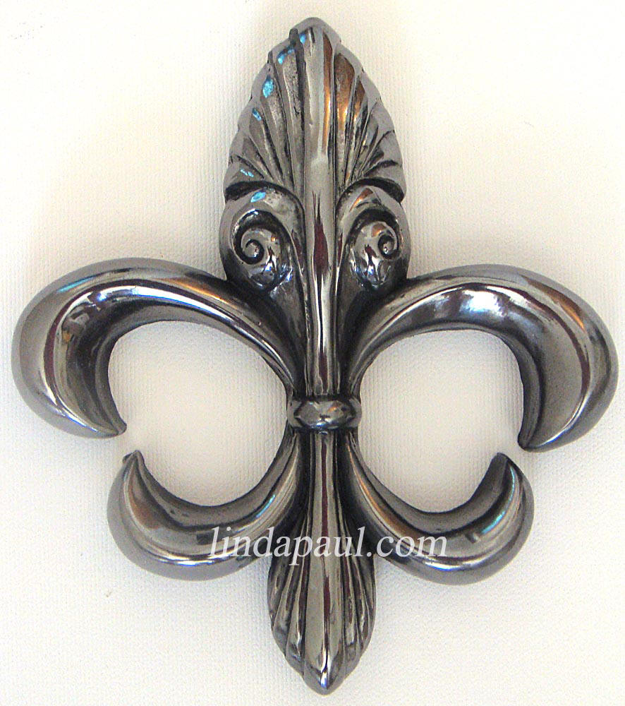 contemporary fleur de lis metal tile accent