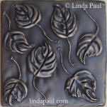 leafdecorative accent  tile in bronze