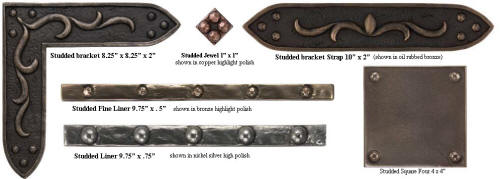 collection of metal studded liners brackets and accents