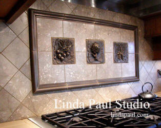 vegetable metal tile backsplash with radishes, artichoke and bunch of carrots tiles