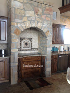 mediterranena kitchen with grapes backsplash medallion