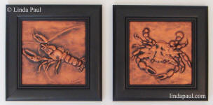 copper crab and crawfish art in square black frames