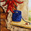 tile with chili peppers and blue string