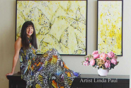 artist Linda Paul with yellw butterfly paintings
