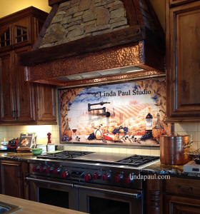 Italian tile backsplash with copper tile trim border