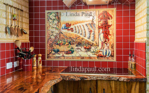 chili pepper mural with red tile wood countertop