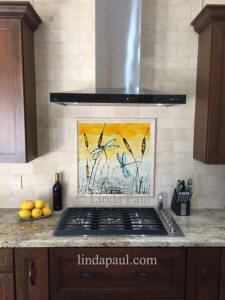 dragonflies artwork in kitchen - above stove