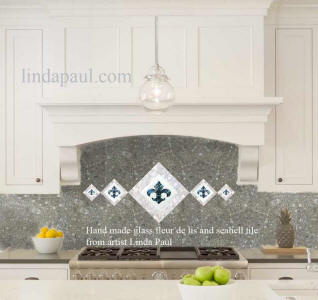 5 fleur de lis glass tile acscent in mother of pearl and antracite terazzo backsplash