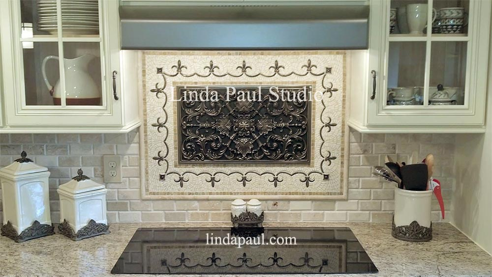 love this studded copper hood with our ravenna backsplash medallion in