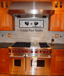 two rooster medallion kitchen backsplash with wolf range