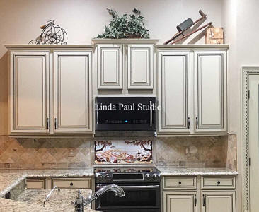 neutral kitchen with 30 x 12 mural over stove