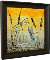 side view of framed dragonfly art glass