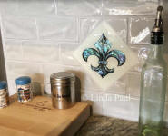 hand-made fleur de lis glass tile