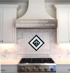 mother of pearl and marble backsplash