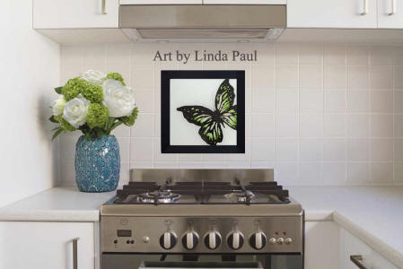green butterfly tile in white kitchen