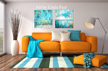 living room with orange sofa and wall art