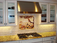 grapes and wine tiles in white kitchen