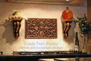 kitchen backsplash ideas with metal plaque and matching corbels