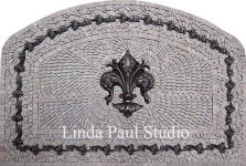 arched fleur de lis stone and metal medallion