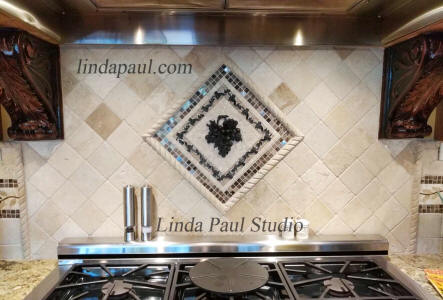 grape and vine mosaic tile backsplash